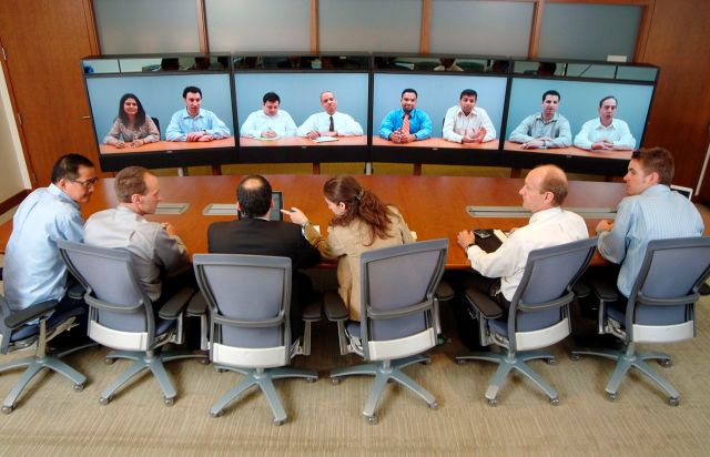 Image of many people participating in a conference call