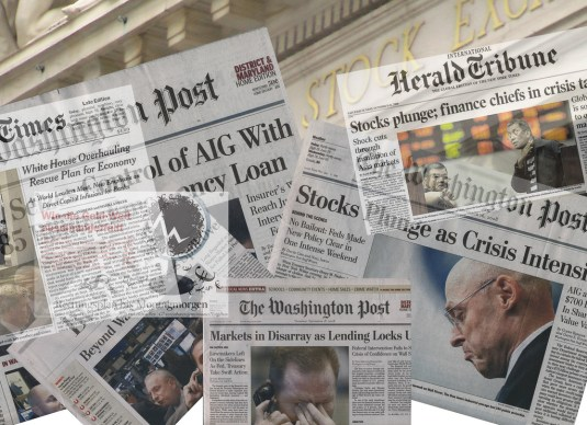 Newspapers with headlines referencing the financial crisis