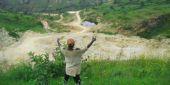 A man indicates the land he has lost at the quarry site