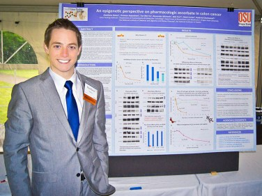 Matt styanding by his poster: An epigenetic perspective on pharmacologic ascorbate in colon cancer