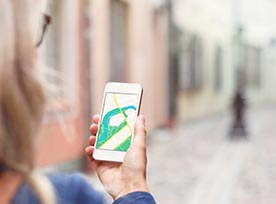Woman using map app on phone