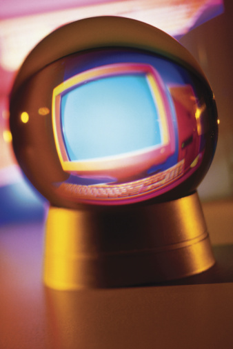Photo of crystal ball displaying computer monitor