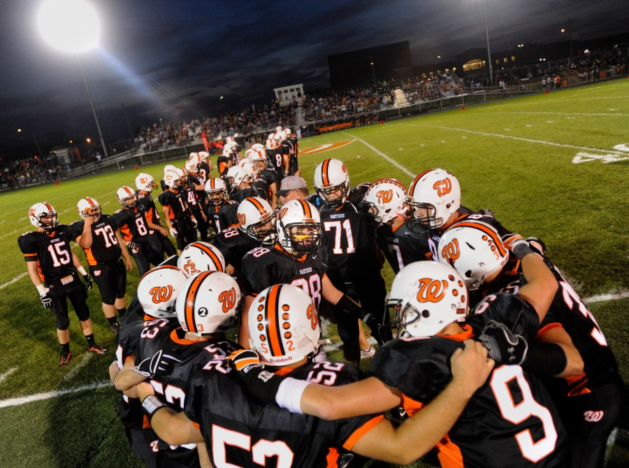 RON JOHNSON/JOURNAL STAR  Washington players huddle before taking the field Friday night against Dunlap.