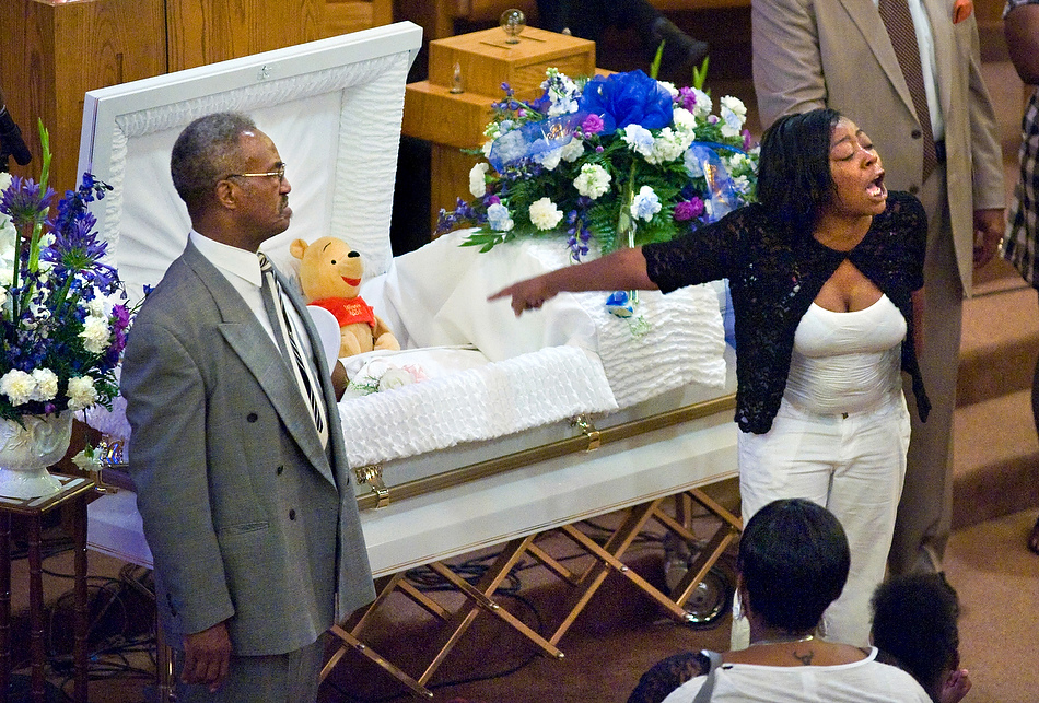 Left Eye In Casket Beside the casket of her