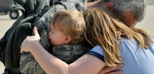 Hugs and kisses for returning guardsmen