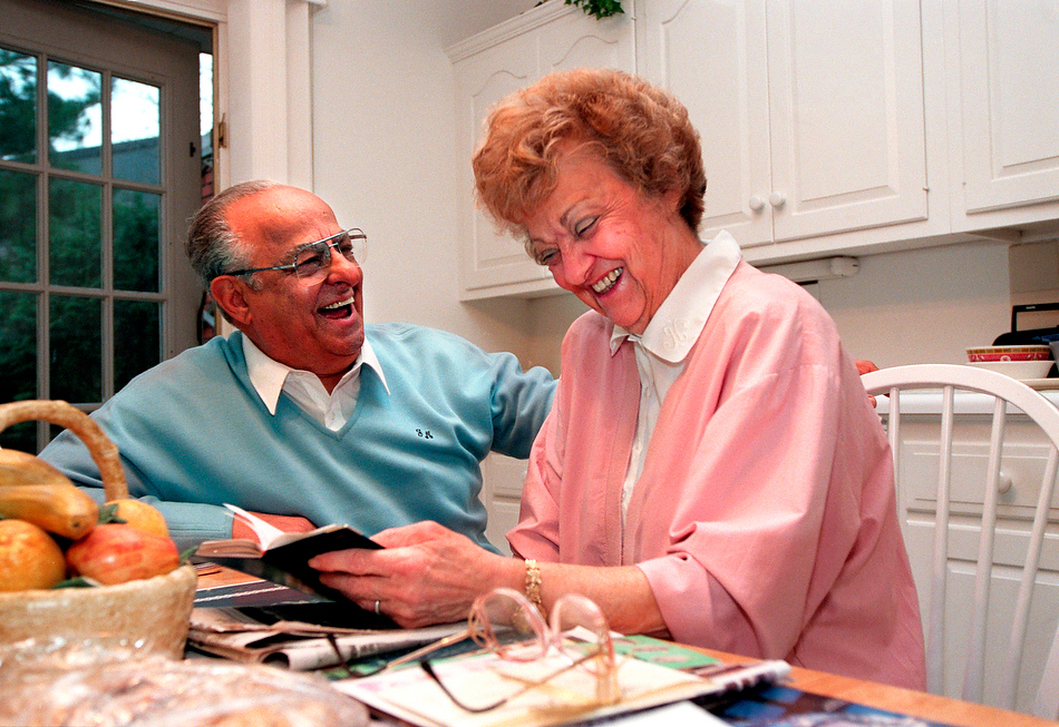 FRED ZWICKY/Journal Star   Jim and Trudy Maloof share a brief quiet moment at their kitchen table back in 1997