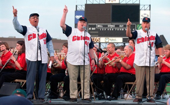 "MATT DAYHOFF/Journal Star  Peoria mayor Dave Ransburg, middle, joins former mayors Jim Maloof, left, and Bud Grieves in the singing of ""Take Me Out To The Ball Game"" with the Peoria Municipal Band during a free concert at O'Brien Field."