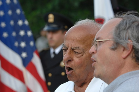 "FRED ZWICKY/JOURNAL STARFormer mayor Jim Maloof and Lee Wenger sing ""God Bless America"" in 2010."