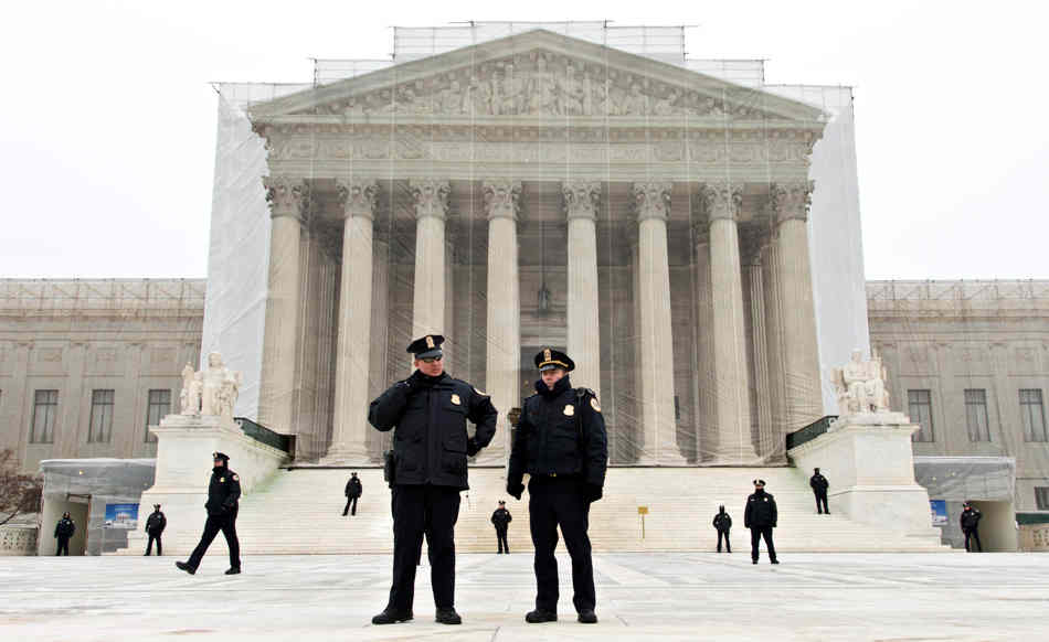 Police officers spread out on the plaza in front of the U.S. Supreme Court as  anti-abortion activists march on the 40th anniversary of the Roe v. Wade decision, in Washington, Friday, Jan. 25, 2013. (AP Photo/J. Scott Applewhite)