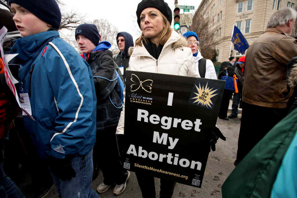 Anti-abortion activists march past the U.S. Supreme Court as they observe the 40th anniversary of the Roe v. Wade decision, in Washington, Friday, Jan. 25, 2013. (AP Photo/J. Scott Applewhite)