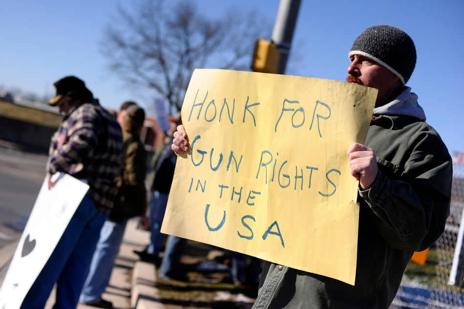 Chris Fritzges, of Milton, Pa., holds a sign in support of gun rights during a demonstration Saturday, Jan. 19, 2013, in Danville, Pa. Rallies are being held by gun rights advocates four days after President Barack Obama unveiled a sweeping plan to curb gun violence.  (AP Photo/The News-Item, Larry Deklinski)