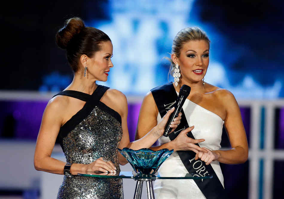 Miss New York Mallory Hytes Hagan, right,  answers a question with host Brooke Burke during the Miss America 2013 pageant on Saturday, Jan. 12, 2013, in Las Vegas. Hytes Hagan was later crowned Miss America 2013. (AP Photo/Isaac Brekken)