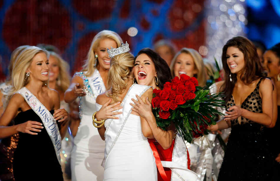 Miss Georgia Leighton Jordan, center, congratulates Miss New York Mallory Hytes Hagan for winning the Miss America 2013 pageant on Saturday, Jan. 12, 2013, in Las Vegas. (AP Photo/Isaac Brekken)