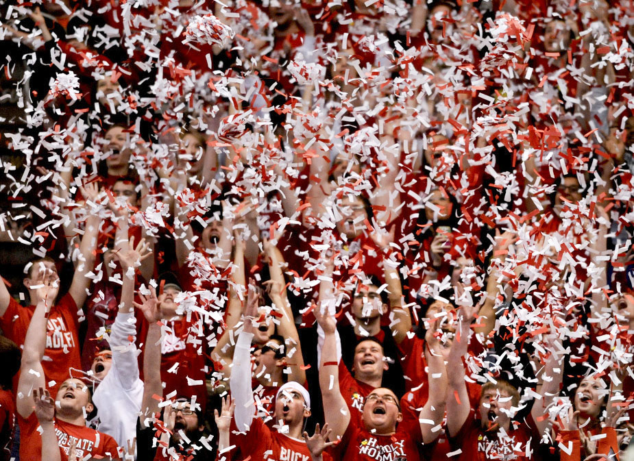 RON JOHNSON/JOURNAL STAR  Illinois State students throw confetti into the air after ISU scored in the opening moments during Wednesday's game at Redbird Arena in Normal.