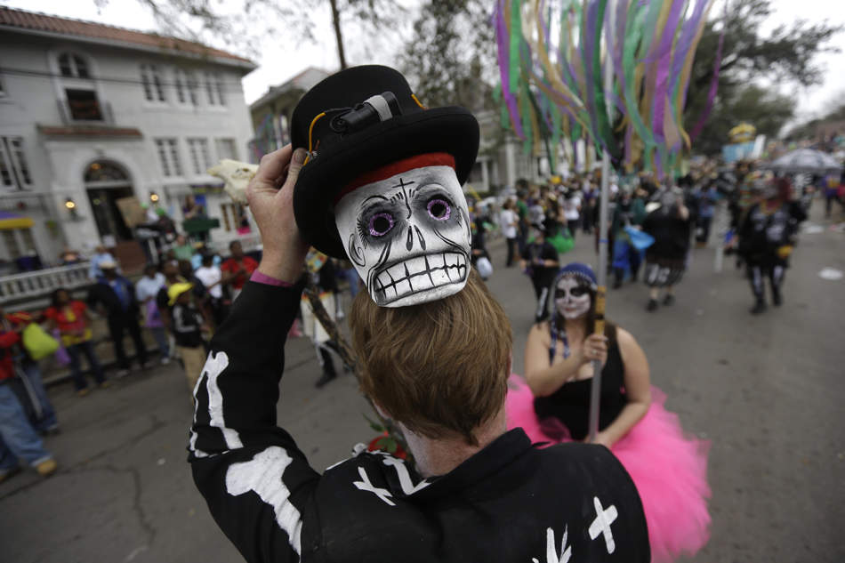 A reveler shows off his mask during the Krewe of Okeanos parade in New Orleans, Sunday, Feb. 10, 2013. (AP Photo/Gerald Herbert)