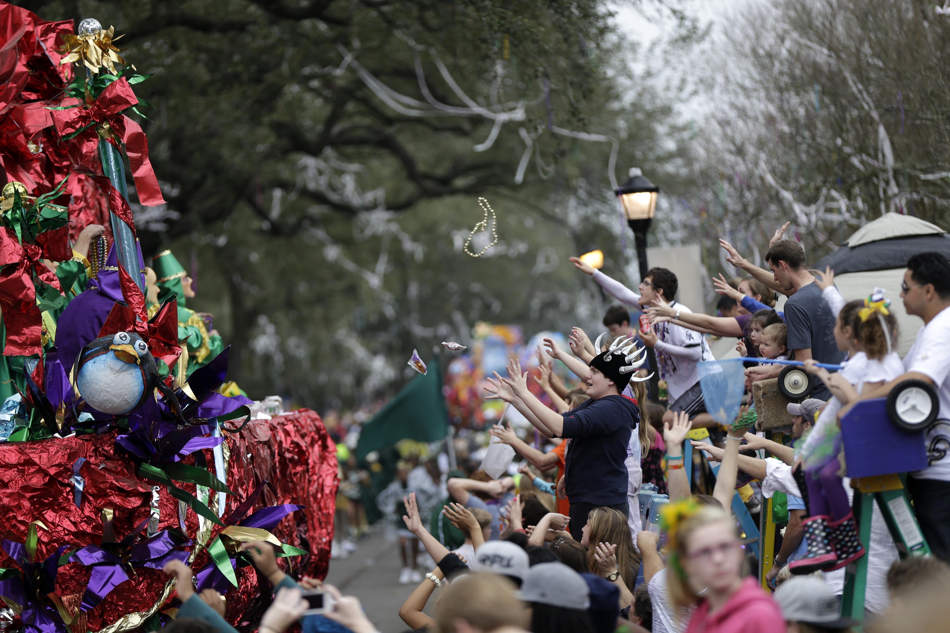Floats pass down Napoleon Ave. during the Krewe of Mid-City Mardi Gras parade in New Orleans, Sunday, Feb. 10, 2013. (AP Photo/Gerald Herbert)