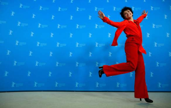 Actress Juliette Binoche jumps during the photo call for the film Camille Claudel 1915 at the 63rd edition of the Berlinale, International Film Festival in Berlin, Tuesday, Feb. 12, 2013. (AP Photo/Gero Breloer)