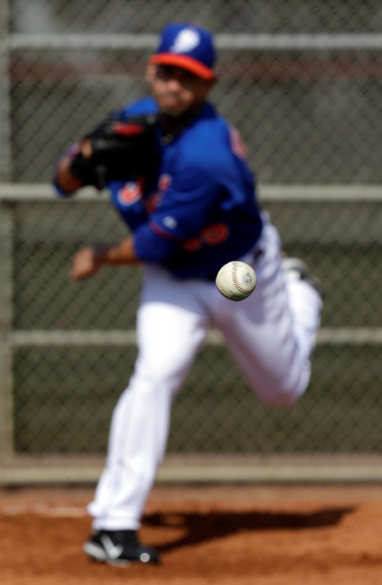 New York Mets non-roster invitee pitcher Pedro Feliciano throws to a catcher during a bullpen session during the team's first pitchers and catchers workout at spring training baseball, Wednesday, Feb. 13, 2013, in Port St. Lucie, Fla. (AP Photo/Julio Cortez)