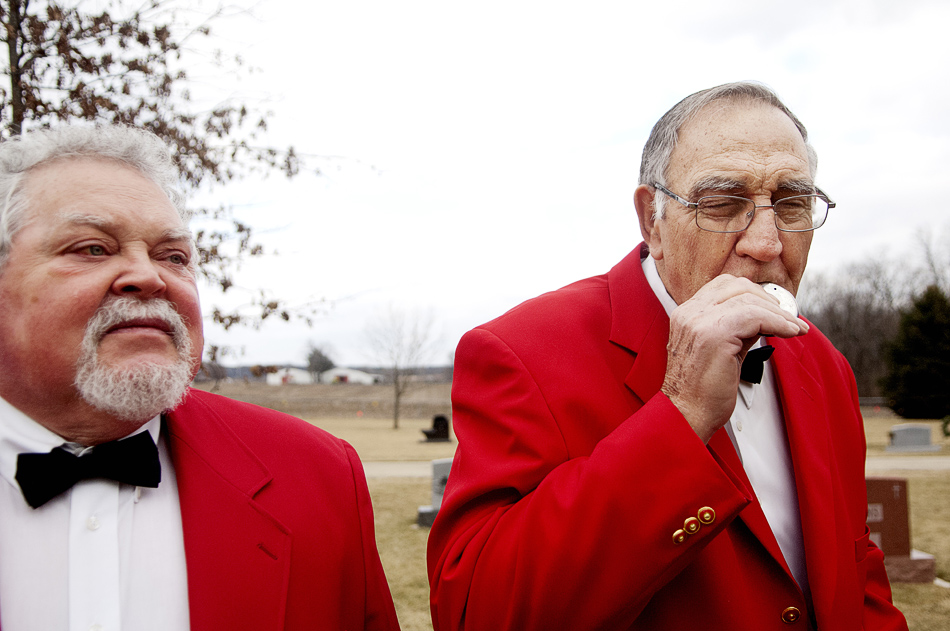 NICK SCHNELLE/JOURNAL STAR  Mike Cosner and Loren Dallinger of the Pride of Peoria Quartet prepare to sing to the grave of Vicki Elward, the wife of former barbershop quartet singer Don Elward, on Thursday at Hirstein Cemetery in Morton. The barbershop quartet has sung at the grave for the past 10 years to pay tribute to Vicki.