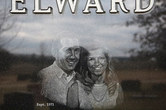 NICK SCHNELLE/JOURNAL STAR  A photo of Don and Vicki Elward is carved into the tombstone of Vicki Elward at the Hirstein Cemetery in Morton. For the past 10 years the Pride of Peoria Quartet has sung at the grave to pay tribute to the wife of fomer barbershop quartet singer Don Elward.