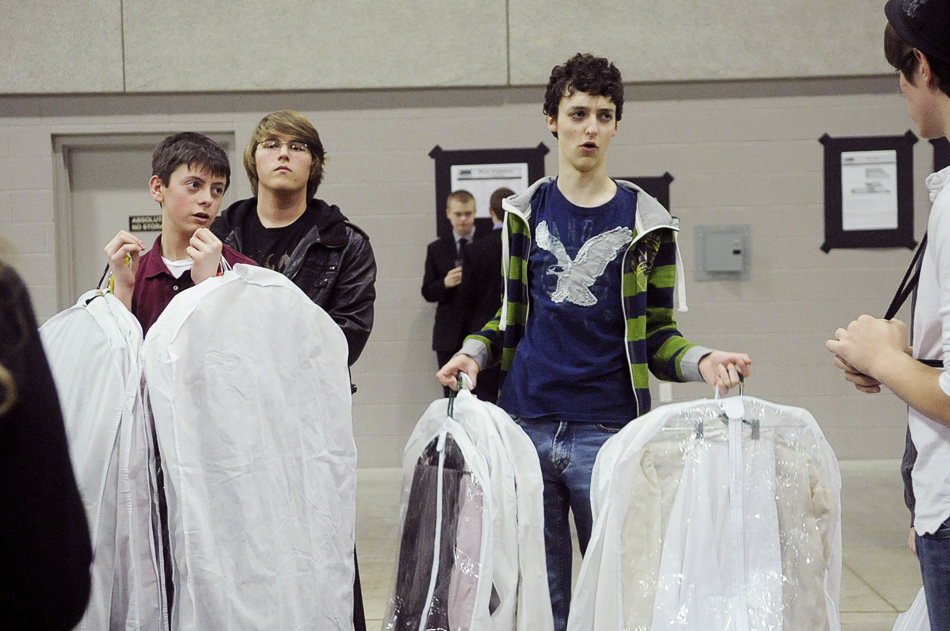NICK SCHNELLE/JOURNAL STAR  Freshman Taylor Yucus and junior Nick Hoffman of Benton Consolidated High School in Benton, Illinois, help carry performance outfits on Friday at the Illinois High School Association State Speech Tournament at the Peoria Civic Center. Students from across the state competed in a variety of events, including Dramatic Interpretation and Original Comedy.
