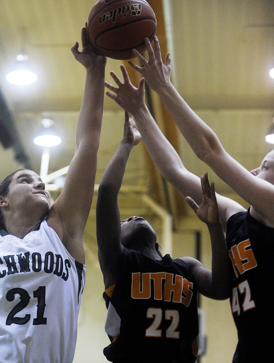 NICK SCHNELLE/JOURNAL STAR  From left, Gabby Cunningham (21) of Richwodos, United Township's ShaTavia Lowery (22) and Katie Daggett battle for the ball on Friday at a Class 4A Regional Championship game at Richwoods High School. Richwoods defeated United Township 57-42.