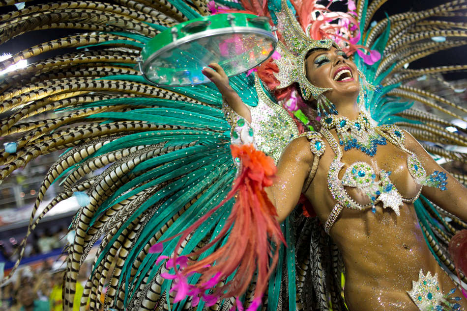 A performer from the Mangueira samba school parades during carnival celebrations at the Sambadrome in Rio de Janeiro, Brazil, Monday, Feb. 11, 2013. (AP Photo/Felipe Dana)