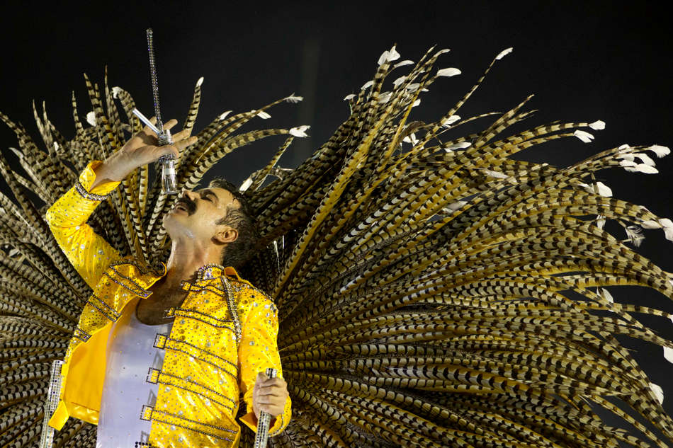 A performer from the Mocidade Independente de Padre Miguel samba school sings on a float during carnival celebrations at the Sambadrome in Rio de Janeiro, early Monday, Feb. 11, 2013. (AP Photo/Felipe Dana)