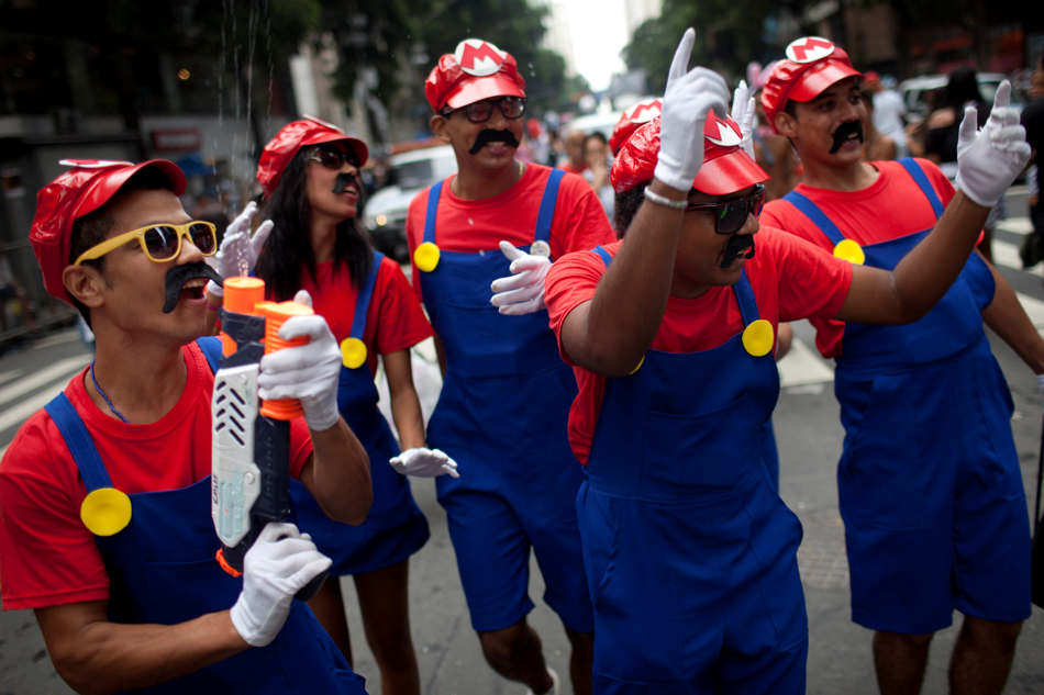 Revelers dressed as arcade character Mario Bros dance during the &quot;Cordao da Bola Preta&quot; street carnival parade in Rio de Janeiro, Brazil, Saturday, Feb. 9, 2013. According to Rio's tourism office, Rio's street Carnival this year will consist of 492 block parties, attended by an estimated five million Carnival enthusiasts. (AP Photo/Felipe Dana)