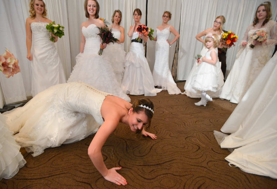 RON JOHNSON/JOURNAL STAR   Models goof around backstage during the Wedding of a Lifetime bridal show at the Peoria Civic Center Ballroom