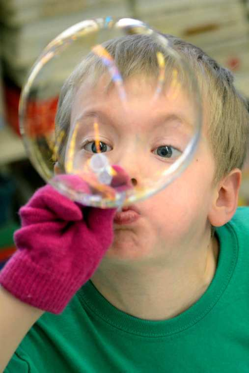 DAVID ZALAZNIK/JOURNAL STAR  Lincoln Horstmann blows a bubble during a visit to Concordia Lutheran School for the Concordia Science Institute, where he and other children from Redeemer Lutheran Preschool and Child Care were introduced to principles of science, in this case, surface tension.
