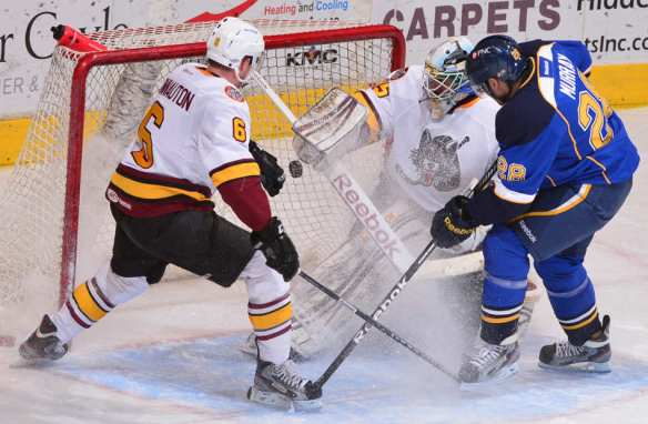 FRED ZWICKY/JOURNAL STAR Peoria's Andrew Murray scores against Chicago Wolves goalie Joe Cannata to put the Rivermen up 1-0 in the second period of a mid-morning Rivermen Faceoff Field Trip game at Carver Arena.