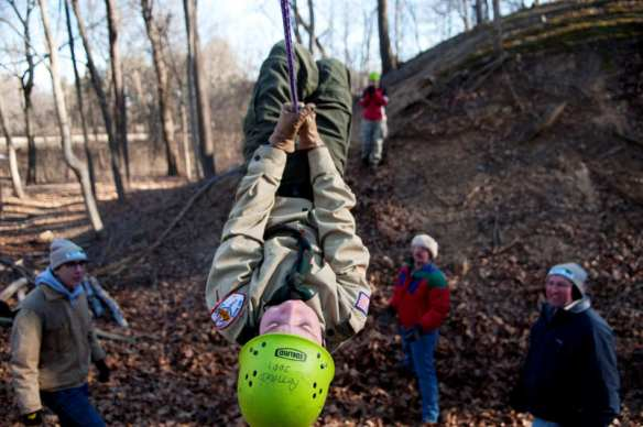 "NICK SCHNELLE/JOURNAL STAR   Ben Rixstine, 12, of Boy Scoout Troop 1 hangs from a rope as he attempts to cross a crevasse during the Heartland District ""Moose on the Loose"" Klondike Derby at Camp Wokanda."
