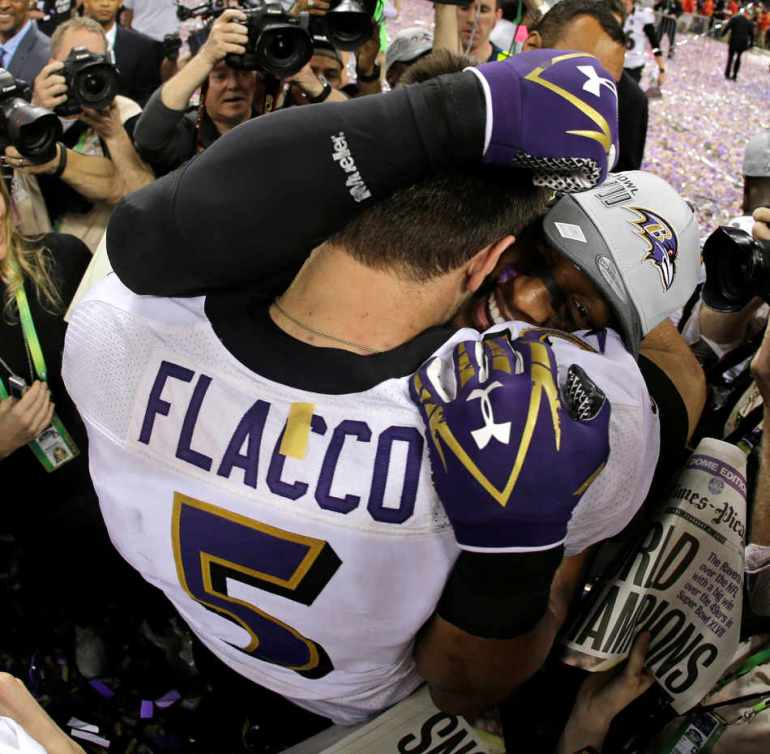 Baltimore Ravens quarterback Joe Flacco (5) embraces linebacker Ray Lewis after defeating the San Francisco 49ers 34-31 in the NFL Super Bowl XLVII football game, Sunday, Feb. 3, 2013, in New Orleans. (AP Photo/Matt Slocum)