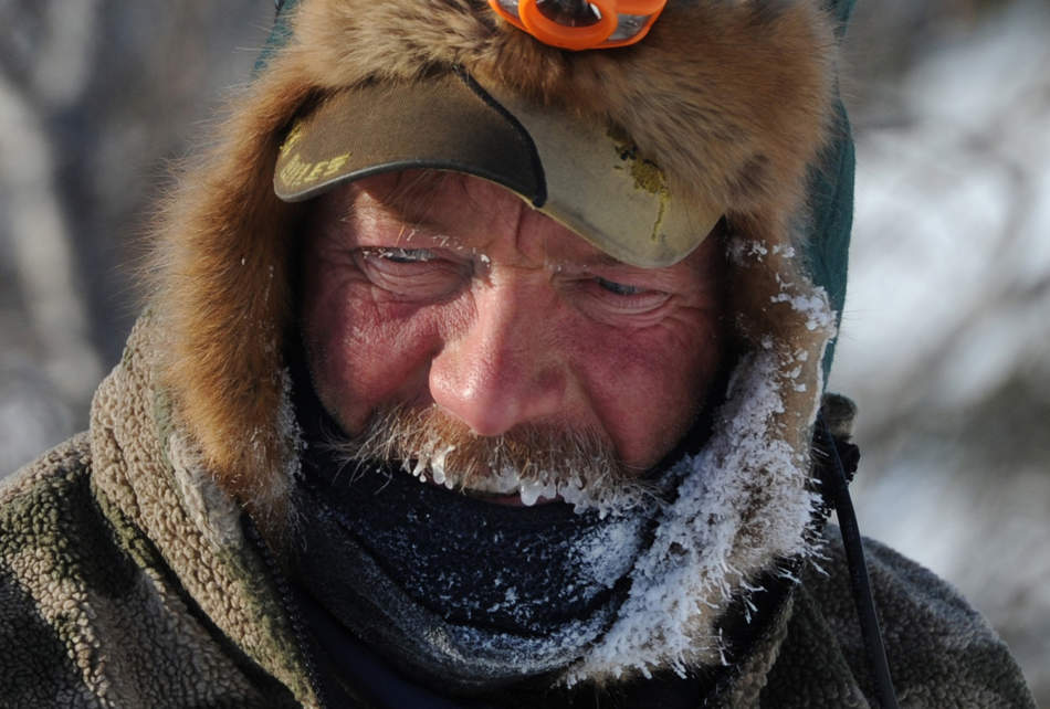 A frost covered Sonny Lindner begins his checkpoint routine in Koyuk in Alaska during the Iditarod Trail Sled Dog Race on Monday, March 11, 2013. (AP Photo/The Anchorage Daily News, Bill Roth)