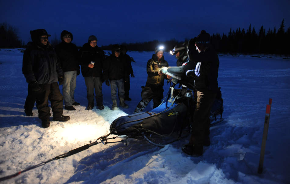 Volunteers check in Aaron Peck into the Iditarod checkpoint of Nikolai during the Iditarod Trail Sled Dog Race in Alaska, Tuesday, Mar. 5, 2013. (AP Photo/The Anchorage Daily News, Bill Roth) LOCAL TV OUT (KTUU-TV, KTVA-TV) LOCAL PRINT OUT (THE ANCHORAGE PRESS, THE ALASKA DISPATCH)