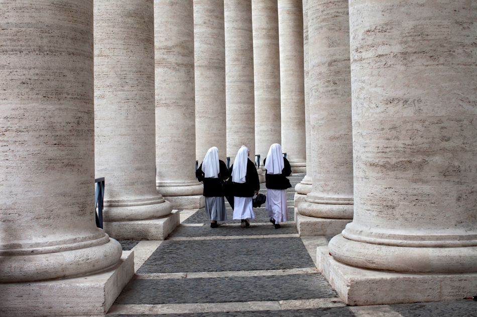 Nuns walk in the Bernini Colonnade in St. Peter's Square on the second day of the conclave to elect a new pope, at the Vatican, Wednesday, March 13, 2013. Cardinals remained divided over who should be pope on Wednesday after three rounds of voting, an indication that disagreements remain about the direction of the Catholic church following the upheaval unleashed by Pope Benedict XVI's surprise resignation. (AP Photo/Oded Balilty)