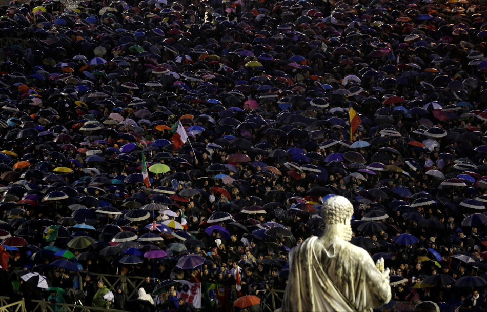 People gather in St. Peter's Square at the Vatican, Wednesday, March 13, 2013. Cardinals remained divided over who should be pope on Wednesday after three rounds of voting, an indication that disagreements remain about the direction of the Catholic church following the upheaval unleashed by Pope Benedict XVI's surprise resignation. (AP Photo/Luca Bruno)
