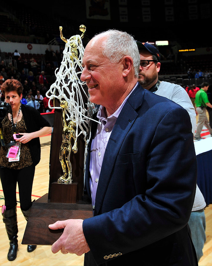 FRED ZWICKY/JOURNAL STAR Gov. Pat Quinn delivers the trophy as Harrisburg defeats Seton 50-44 to claim the IHSA Class 2A title game Saturday night at the Peoria Civic Center.