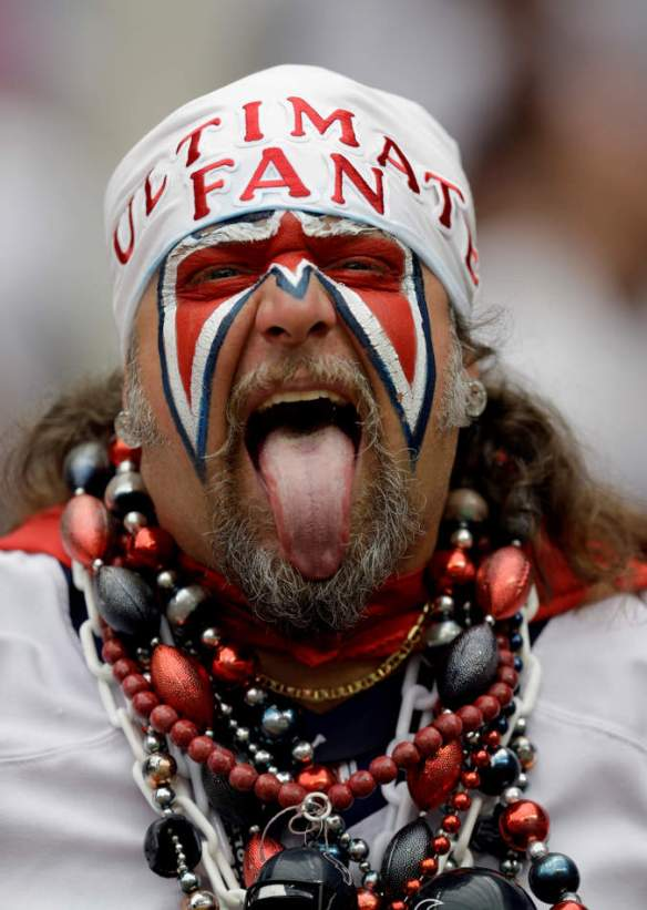 A Houston Texans fan shows his support for the team during the second quarter of an NFL football game against the Tennessee Titans Sunday, Sept. 15, 2013, in Houston. (AP Photo/David J. Phillip)