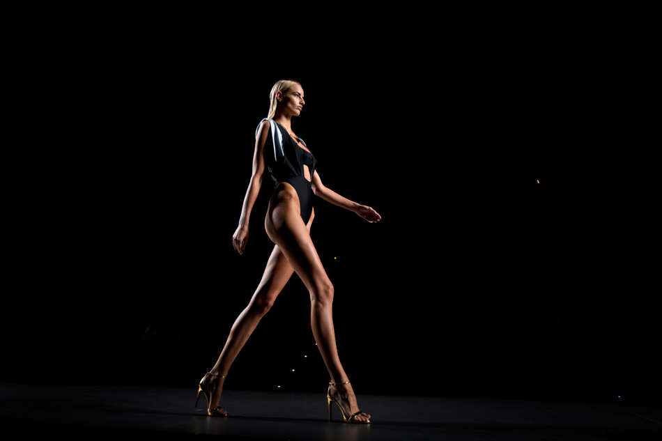 A model displays a Spring/Summer design by Ana Locking during Madrid's Fashion Week, in Madrid, Spain, Friday, Sept. 13, 2013. (AP Photo/Daniel Ochoa de Olza)