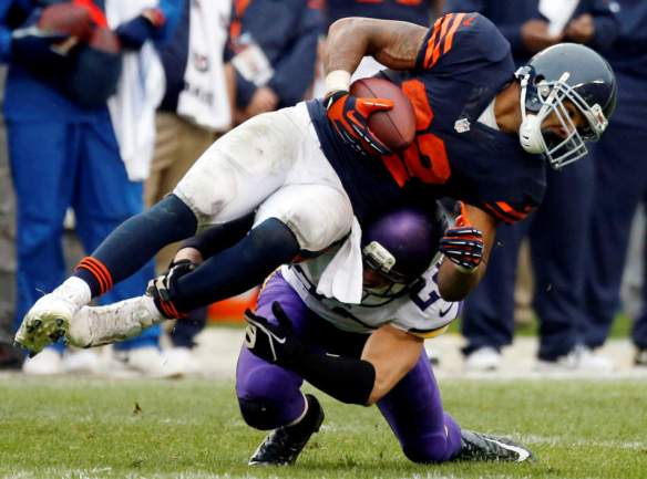 Chicago Bears running back Matt Forte, top, is tackled by Minnesota Vikings safety Harrison Smith during the second half of an NFL football game on Sunday, Sept. 15, 2013, in Chicago. (AP Photo/Charles Rex Arbogast)