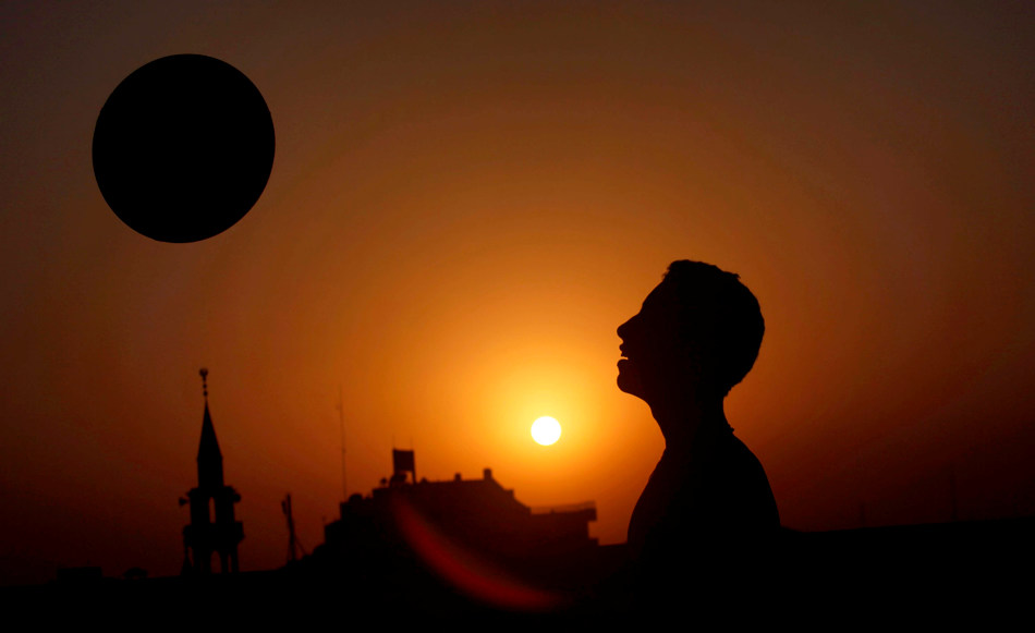 A Palestinian youth plays with a ball, as they sun sets in Gaza City, Tuesday, Oct. 29, 2013. (AP Photo/Hatem Moussa)