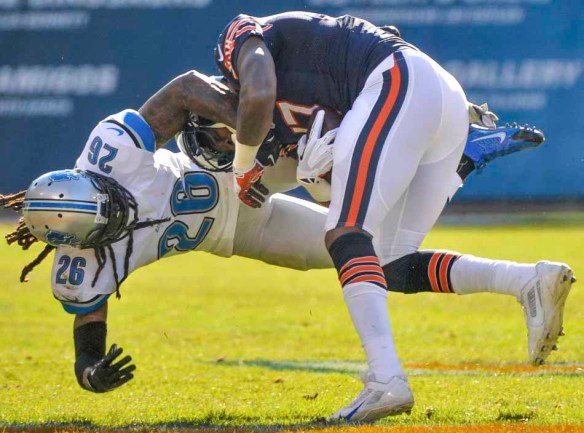 RON JOHNSON/JOURNAL STAR  Lions safety Louis Delmas tries to bring down Bears receiver Alshon Jeffery after a reception.