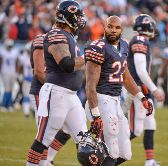 RON JOHNSON/JOURNAL STAR  Bears running back Matt Forte (22) and teammates walk off the field after Sunday's 21-19 loss to the Lions.