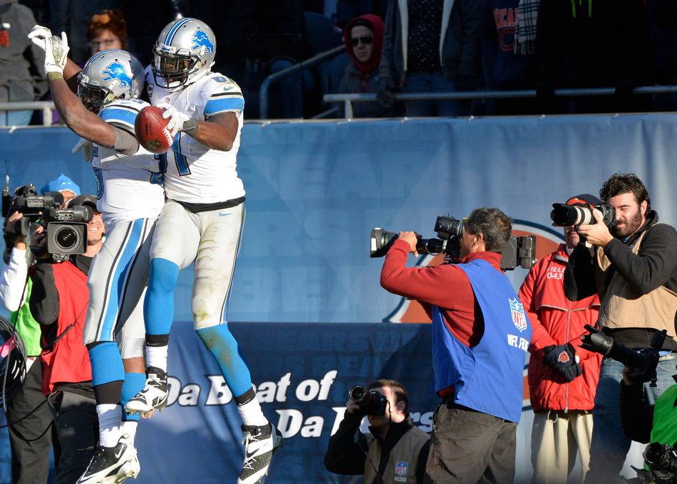 RON JOHNSON/JOURNAL STAR  Lions receiver Calvin Johnson celebrates his fourth quarter touchdown.