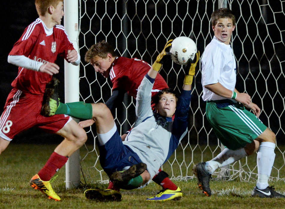 RON JOHNSON/JOURNAL STAR   Peoria Notre Dame goalie Justin Buck grabs a shot on goal from Morton during the Class Class 2A sectional final on Nov.  2 in Morton. Notre Dame won 1-0 to advance to the supersectional.