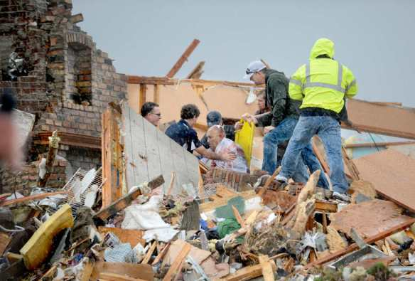DAVID ZALAZNIK/JOURNAL STAR  Rescuers pull an injured resident from a demolished house after a tornado destroyed parts of Washington on Nov. 17.