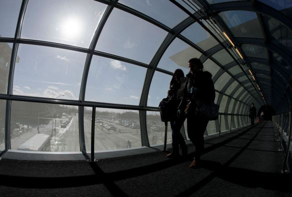Students on the campus of IUPUI use a tunnel to walk between buildings Monday, Jan. 27, 2014, in Indianapolis. Below-zero high temperatures have returned to many parts of the Midwest bringing with it wind chills ranging from the negative teens to 40-below.(AP Photo/Darron Cummings)