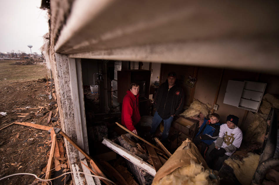 FRED ZWICKY/JOURNAL STAR On Nov. 17, Brevin Hunter, 6, in blue, ushered his mom Lisa (not pictured) and brother Brody, 11, in white, into the basement of their Washington rental home. As their dad, Jesse, tried to get home, the tornado hit, leveling the house. Jesse was spun around in his truck multiple times by the tornado. The family lost everything they own and did not have rental insurance. Their other son, Brayden, 15, in red, was at his grandparents.